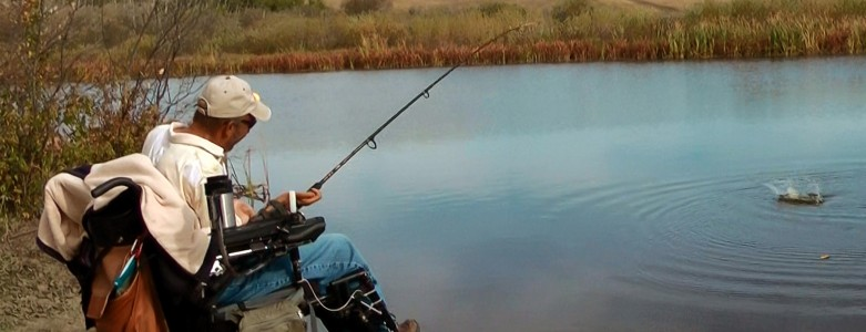 Kary fishing by a beautiful lake