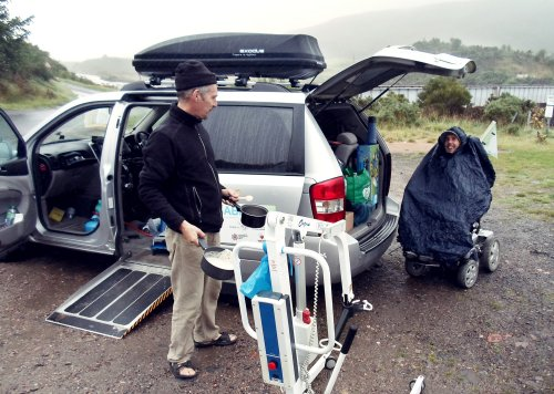 Martyn Sible sheilding from rain on trip from John O'Groats to Land's End