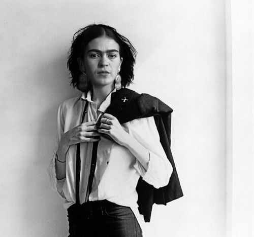 Frida Kahlo in white shirt, black trousers and braces