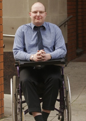 Disabled activist Doug Paulley outside court
