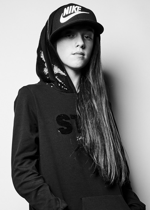 Disabled model Isabella Neville in hoodie