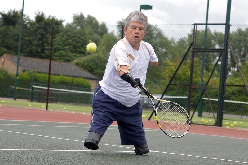 John Willis playing Paralympic tennis