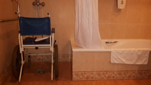 Shower chair in not so accessible bathroom