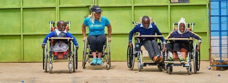Arielle Rausin racing disabled children in wheelchairs