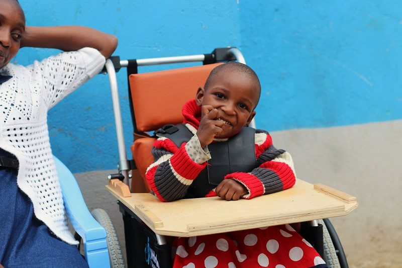Disabled African child in wheelchair