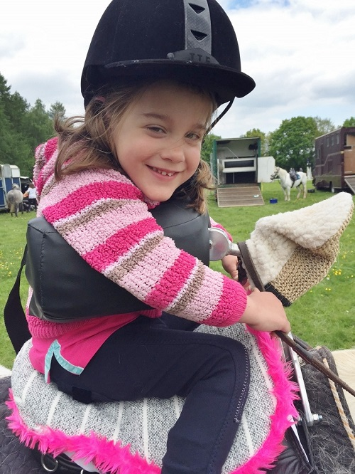 Horse riding aid for disabled child