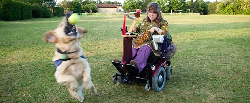 Lady in wheelchair with dog
