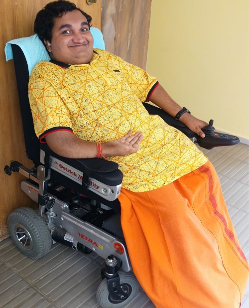 Sai Kaustuv Dasgupta in his electric wheelchair