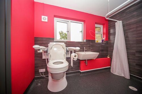Adapted bathroom from Closomat with red wall