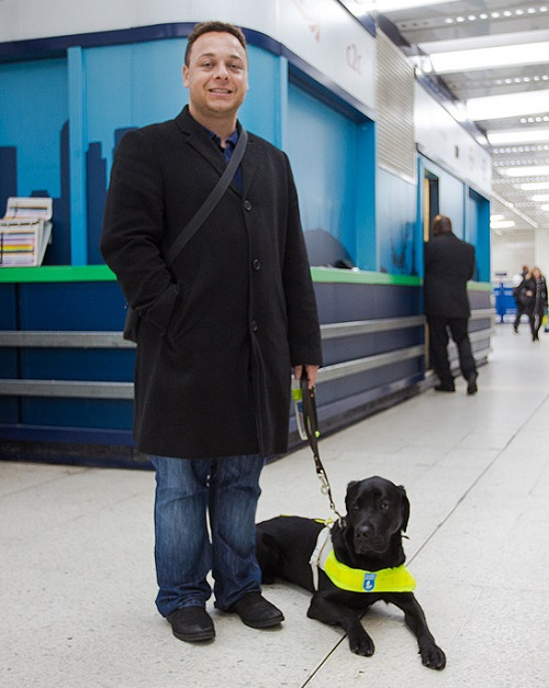 Daniel with this guide dog