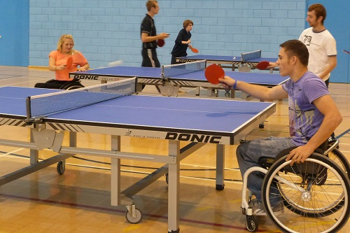 Man in wheelchair playing table tennis