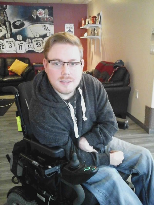 Alex Lytwyn in his wheelchair in his living room