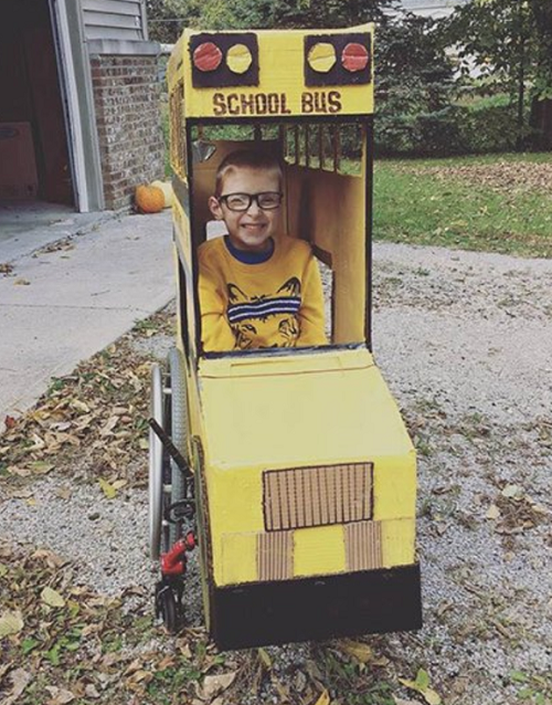 Boy in Hallween costume built around wheelchair