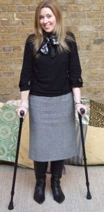 Denise Stephens standing using her walking sticks