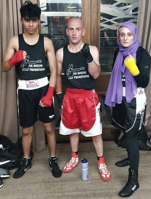 Disabled boxer Sannah Hussain with two male boxers