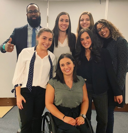 Trainee audiologist Oliva in a wheelchair with her colleagues