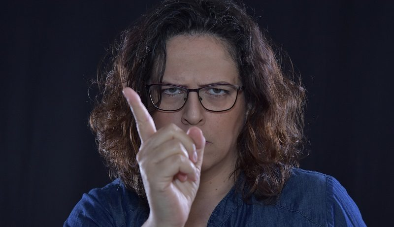 Woman annoyed pointing her finger