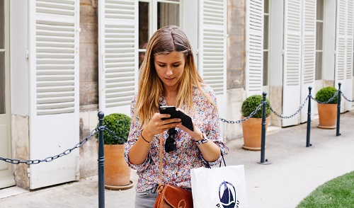 Woman texting and not looking where she is going