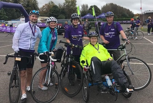 Nick completing cycling challenge in adapted bike