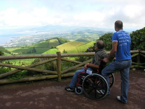 Wheelchair user looking at view on Azores island