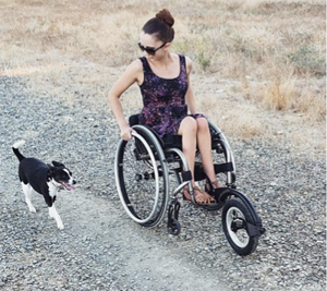 Woman using FreeWheel wheel on wheelchair