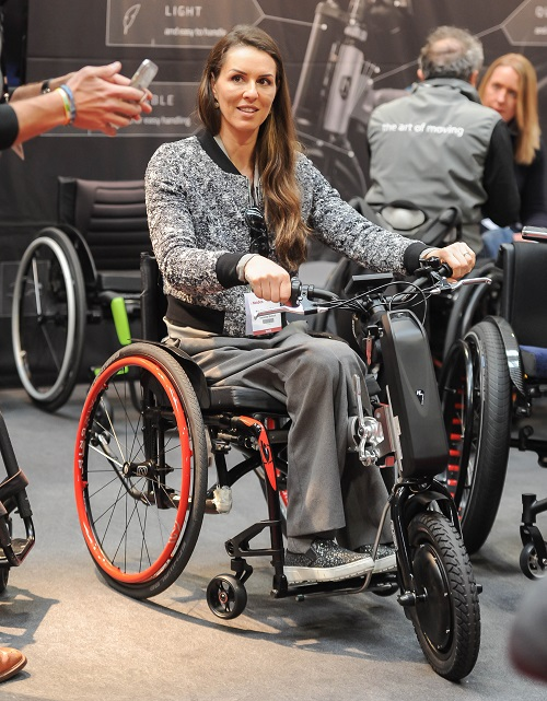 Disabled model Samanta Bullock trying a wheelchair at Naidex 2019