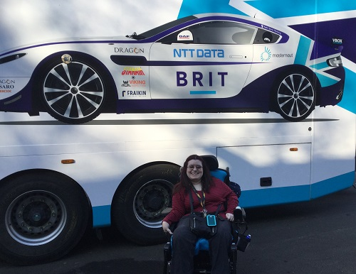 Emma Purcell in wheelchair in front of Team Brit racing car
