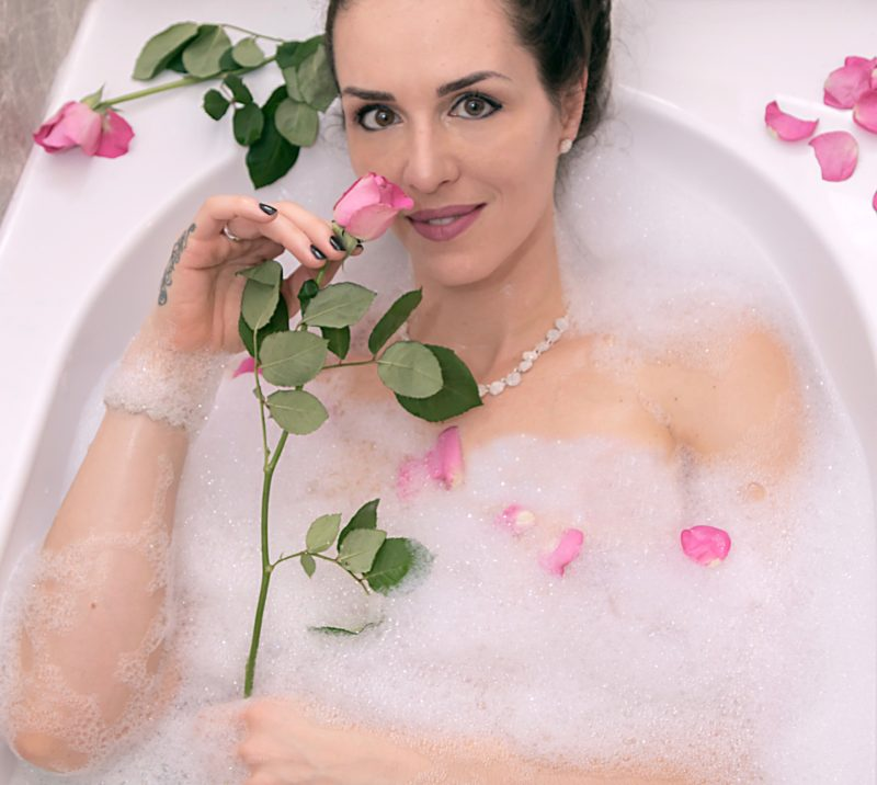 Samanta Bullock in the bath with roses
