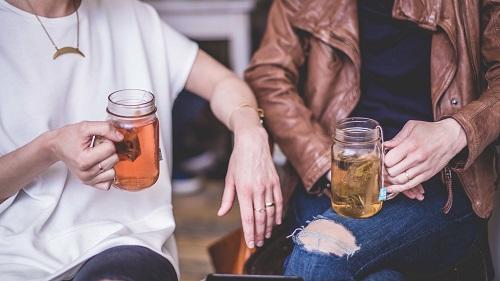 Two women having a drink in a bar
