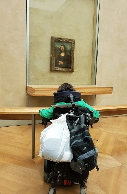 Wheelchair user Derry Felton in the Louvre