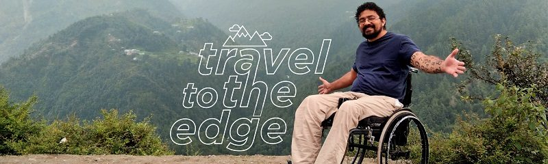 Wheelchair user on the top of a mountain in India