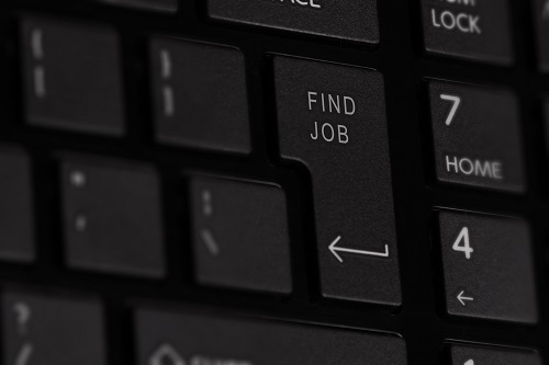 Computer keyboard with words 'find job' on the enter key