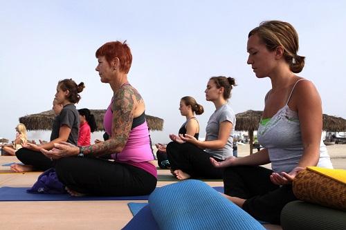 People sitting doing yoga