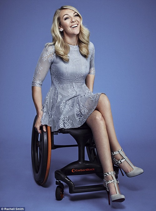 Sophie Morgan in her wheelchair in a blue dress