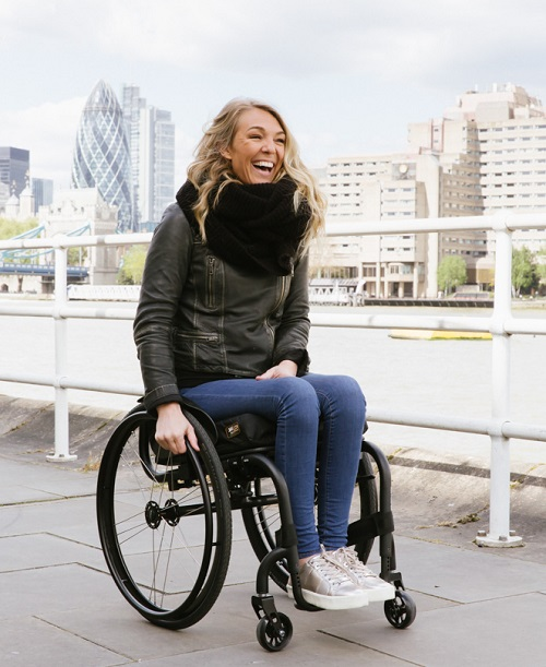 Sophie Morgan in her wheelchair in London by the Thames