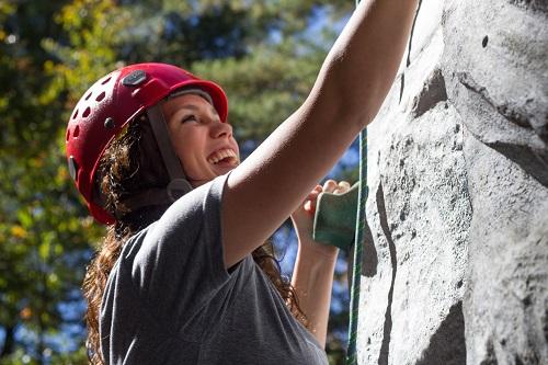 Woman using a climbing wall