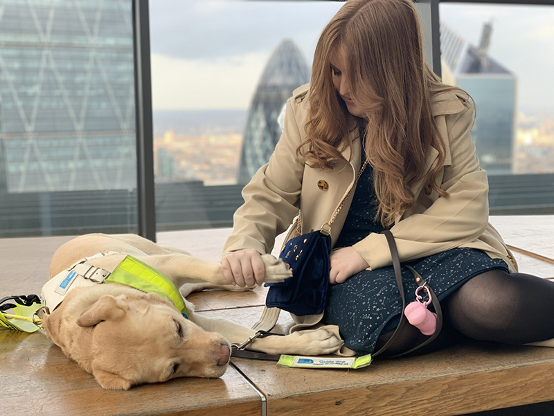 Fashion blogger Emily Davidson with her guide dog