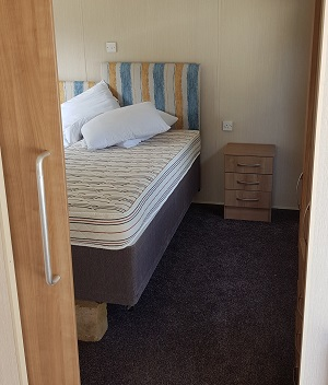 Accessible bedroom in caravan on Isle of Wight
