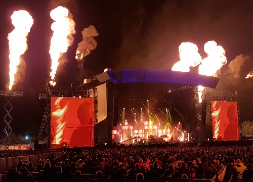 Isle of Wight festival stage at night with fire