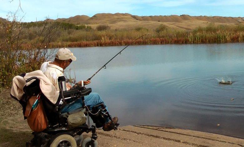 Kary fishing by a beautiful lake