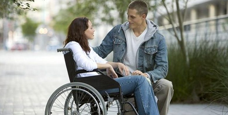 disabled person talking to a stranger