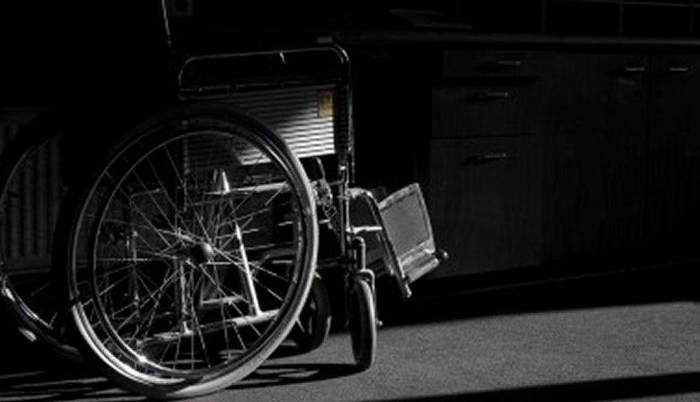 wheelchair in darkness