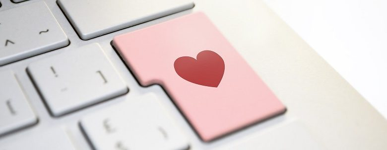 Disabled dating - computer keyboard with heart on enter button