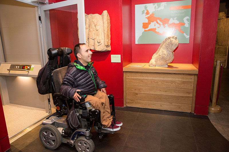 Martin trys out the accessibility of the Roman Baths museum. March 2015. Photographer Freia Turland e:info@ftphotography.co.uk m:07875514528