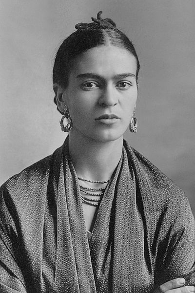 Frida Kahlo wearing a shawl with hair pinned back