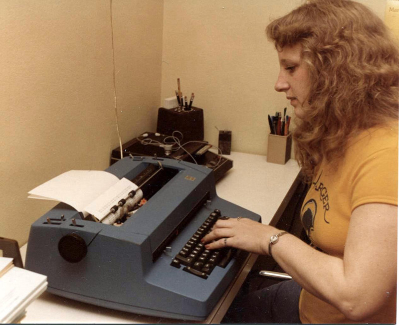 Monica typing with one hand