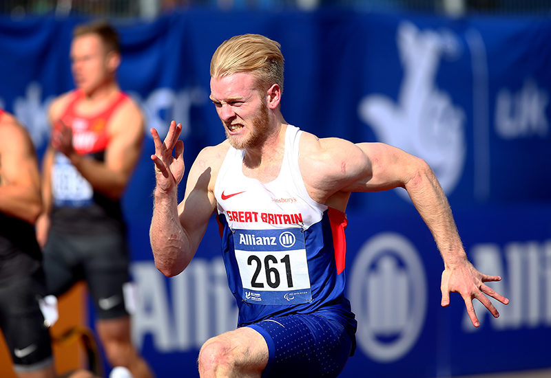 SWANSEA, WALES - AUGUST 19: Jonnie Peacock of Great Britain wins the mens 100m T44 final during day one of the IPC Athletics European Championships at Swansea University Sports Village on August 19, 2014 in Swansea, Wales. (Photo by Charlie Crowhurst/Getty Images)
