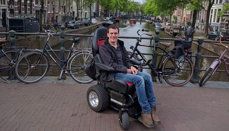 Alex in Freedom One power wheelchair