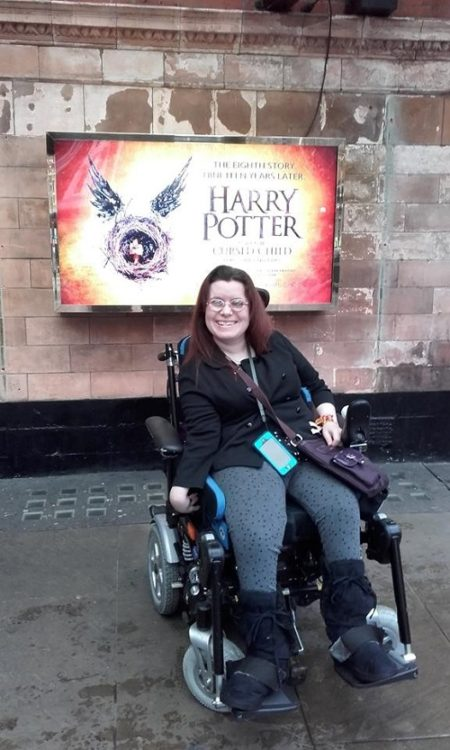 Emma outside Harry Potter in the West End