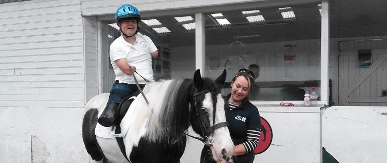 Disabled man John Willis riding a horse